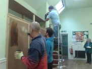 Putting up new cupboards in small halls