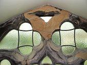 Crumbling stone on clerestory window