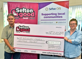 Presentation of cheque to Stephen Green by Sefton CVS